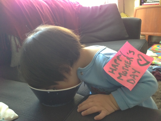 Nate with his face in a bowl of cereal - His way of wishing me a mother's day.