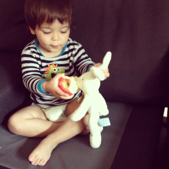 Nate sharing an apple with bunny