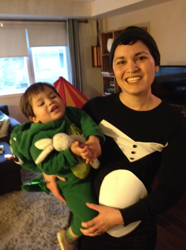 Mommy penguin. Baby dinosaur. (my face still looks a little swollen, and my smile looks a bit off, BUT I am dressed as a penguin!)